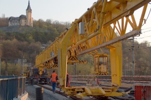 Track layer PKP 25/20 is a special bridge crane designed for laying and removing of 25 m long (and shorter) railway tracks on wooden or concrete sleepers and of maximum weight of 20 tons.
