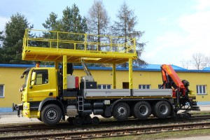 The vehicle is equipped with fixed platform, with loading capacity of 800 kg, used for installing of required equipment at heights as well as with hydraulic loading crane of 22tm capacity, which is located at the rear part of the vehicle and is designed to handle the load, or to work with a basket.