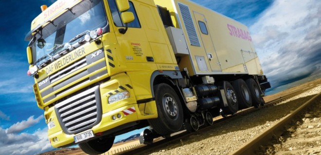 Road-Rail vehicle DAF 8×2 XF 105 WELDERLINER equipped with flash butt welder container; rail gears are hydraulically driven; the rear rotational rail boogie with microdrive enables easier on-tracking